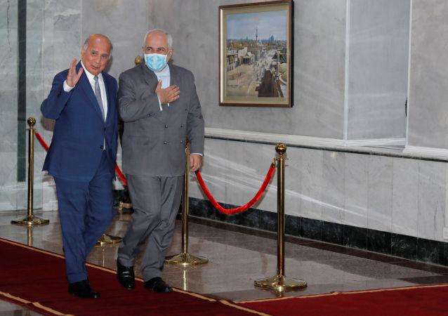 وزیر امور خارجه ایران در سفر به بغداد با فواد حسین وزیر امور خارجه عراق