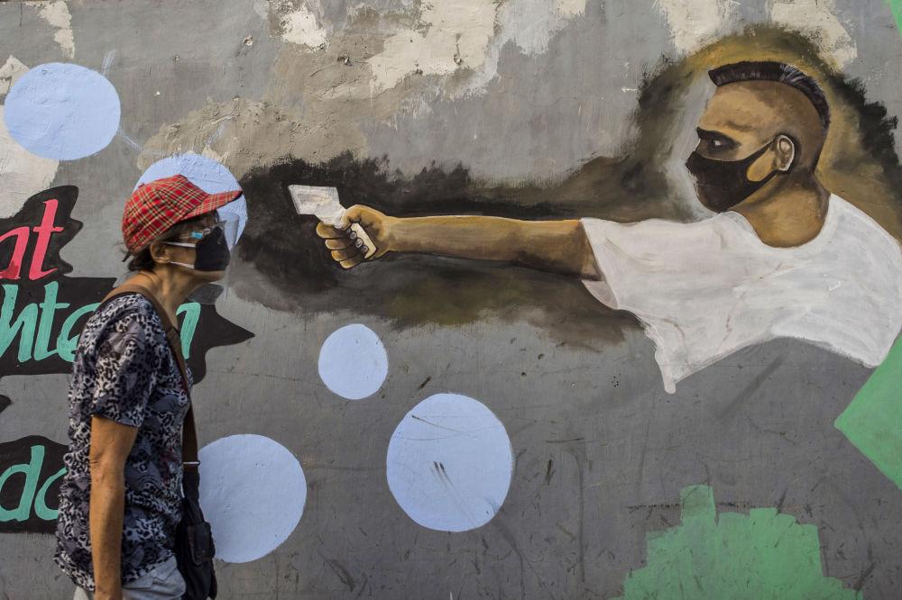گرافیتی مردی با تب سنج در جزیره جاوه اندونزی