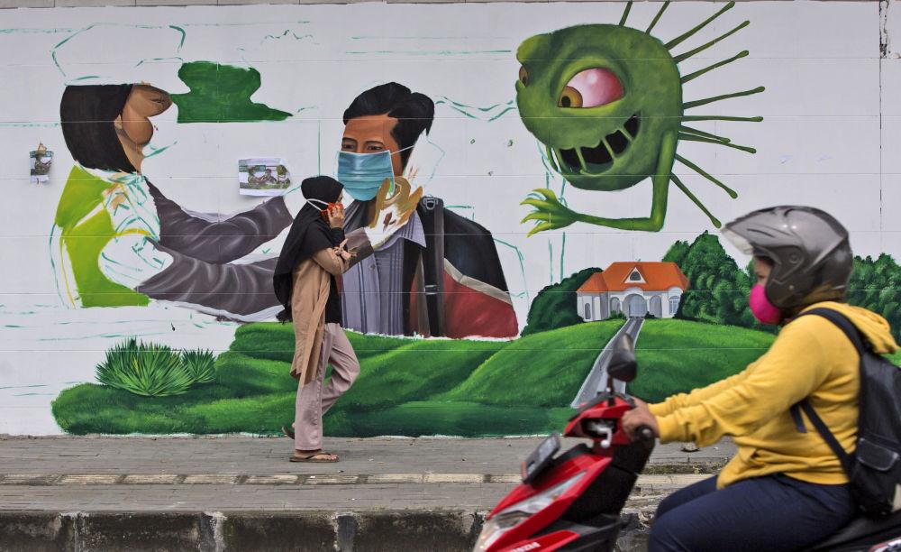 گرافیتی برای یادآوری پوشیدن ماسک در سومارتا