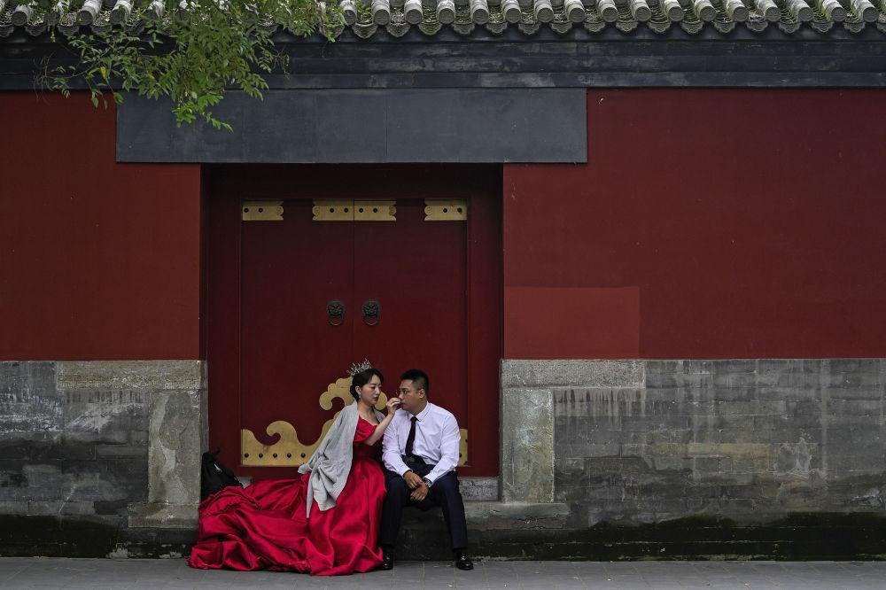 رویدادهای هفته به روایت تصویر عروس و داماد، پکن