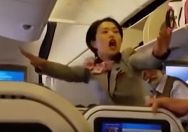 گلاويز شدن دو مسافر در خط هوايي ژاپن (ويدئو)
