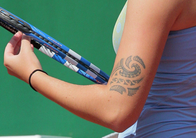 Close-up on Czech Karolina Pliskova arm's tatoo taken on May 18, 2011 at the Roland-Garros stadium in Paris during the Women's first qualifying round of the Grand Slam Roland-Garros tennis tournament. Tournament will run from May 22 to June 5, 2011